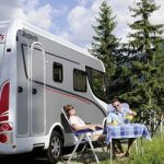 Customers relaxing outside their campervan in Germany.